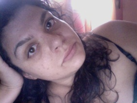 image of author laying on her side, face resting in her hand. she appears tired and wears no makeup.